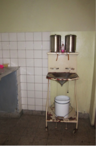 This sink is a hands-free washing and scrub in station for surgery. Notice the foot petals below the station that allow water to flow so that members of the surgical team can scrub-in for surgery. This was designed for a site that did not have reliable running water in eastern Congo